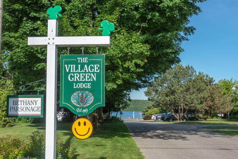 Village Green Lodge sign